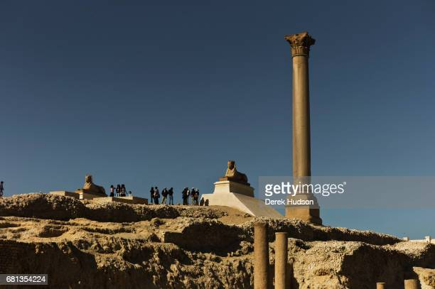 View of Pompey's Pillar two sphinxes and several other structures on the city's ancient acropolis Alexandria Egypt December 19 2009 Originally part...