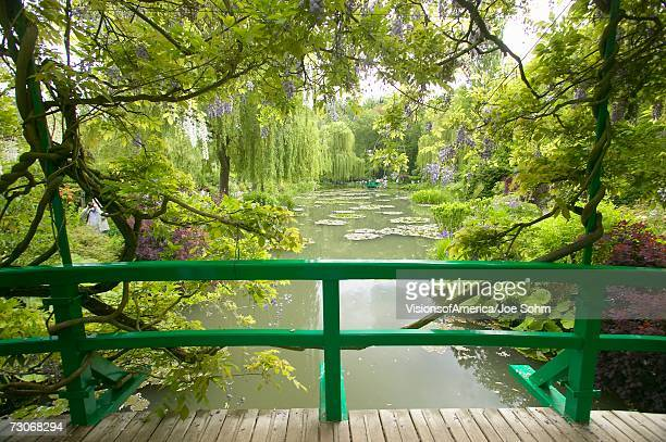 """view of pond and gardens at giverny from monet's bridge, giverny, france"" - claude monet stock pictures, royalty-free photos & images"