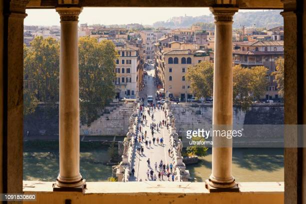 view of ponte umberto i across river tiber from castel sant'angelo in rome at day - column stock pictures, royalty-free photos & images