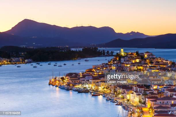 view of poros island and mountains of peloponnese peninsula in greece. - peninsula de grecia fotografías e imágenes de stock