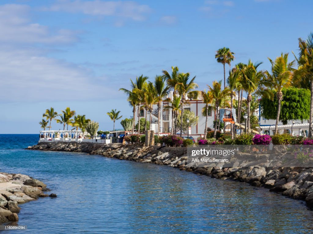 View of Port of Mogan village with white houses on the seashore : Stock Photo