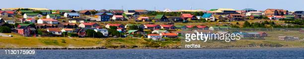 view of port stanley from the harbor - houses in antarctica stock pictures, royalty-free photos & images