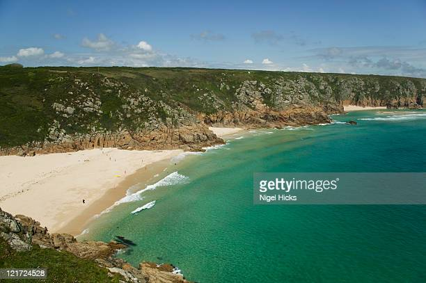 a view of porthcurno beach from the minack theatre, nr penzance, cornwall, great britain. - minack theatre stock pictures, royalty-free photos & images