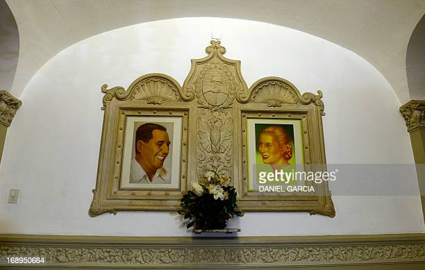 View of portraits of former Argentine President Juan Domingo Peron and his wife Eva Duarte de Peron Evita displayed at the main hall of the Evita...