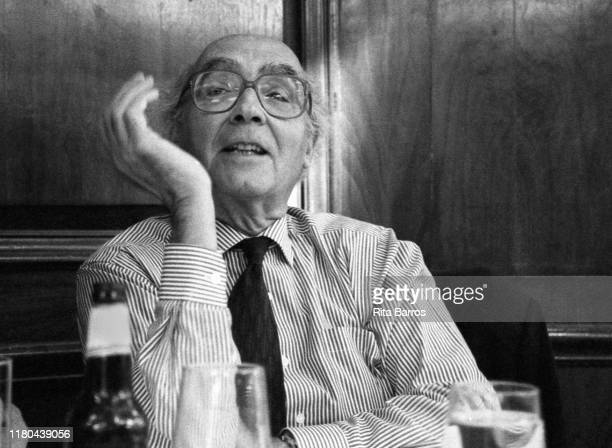 View of Portuguese writer Jose Saramago as he sits at a table in an unidentified restaurant, New York, New York, September 23, 1996.