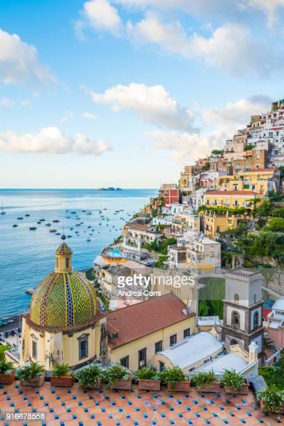 view of positano cityscape and coastline - amalfi coast stock photos and pictures
