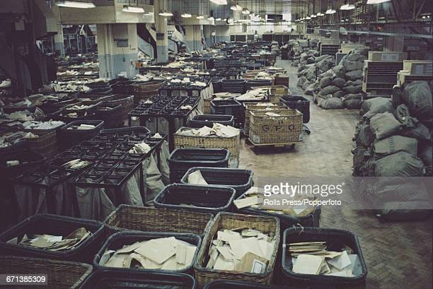View of post office mail bags parcels and letters piled up at Mount Pleasant sorting office and mail centre in London during a national strike by...