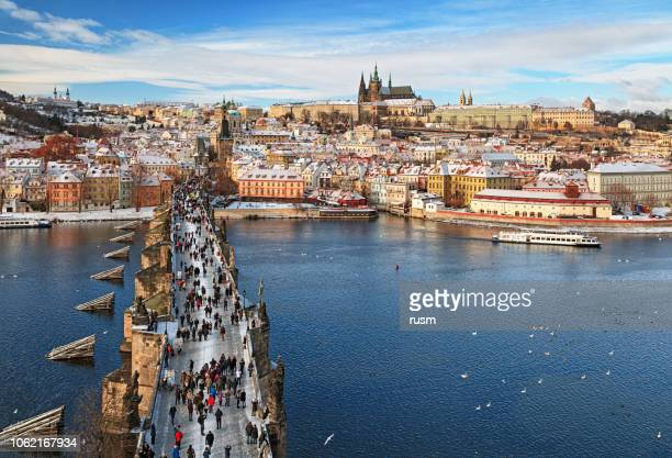 view of prague and charles bridge at winter - bohemia czech republic stock pictures, royalty-free photos & images