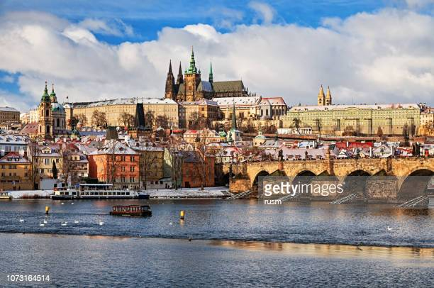 view of prague and charles bridge at winter - prague stock pictures, royalty-free photos & images