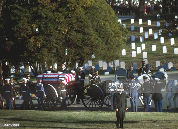View of President John F Kennedy's funeral procession as the president's flagcovered casket on a horsedrawn caisson arrives at Arlington National...