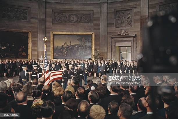 View of President Richard Nixon and members of his family attending the lying in state of former President Dwight D Eisenhower with the President's...