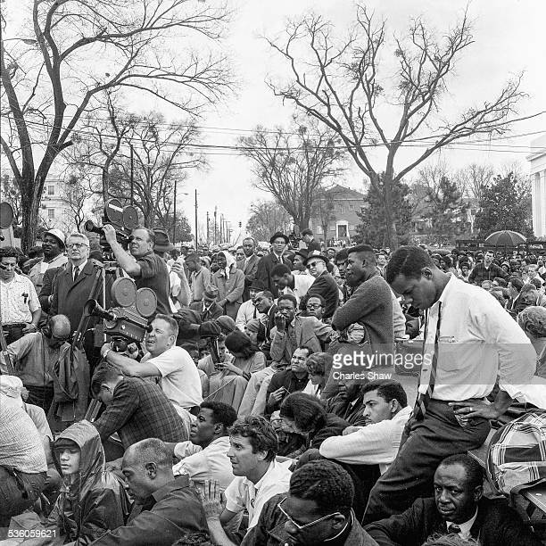 View of press marchers and spectators directly below the podium to listen to speakers at the end at the end of the Selma to Montgomery March...
