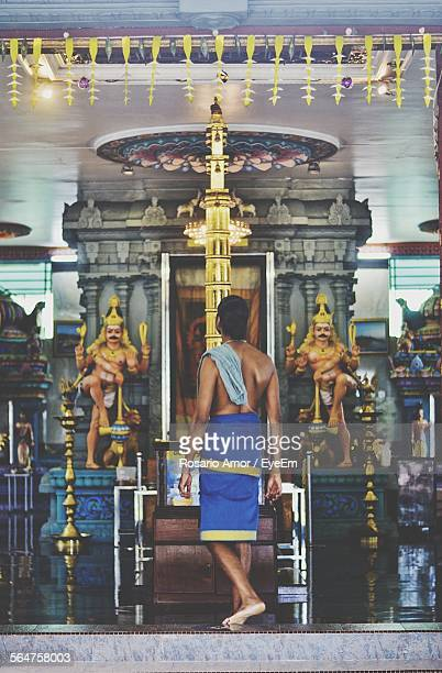 view of priest in temple - brahmin stock pictures, royalty-free photos & images