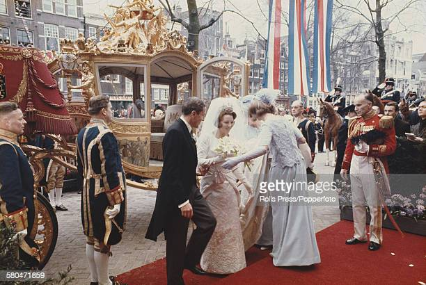 View of Princess Beatrix later Queen Beatrix of the Netherlands leaving the royal coach with her husband Claus von Amsberg Prince Claus of the...