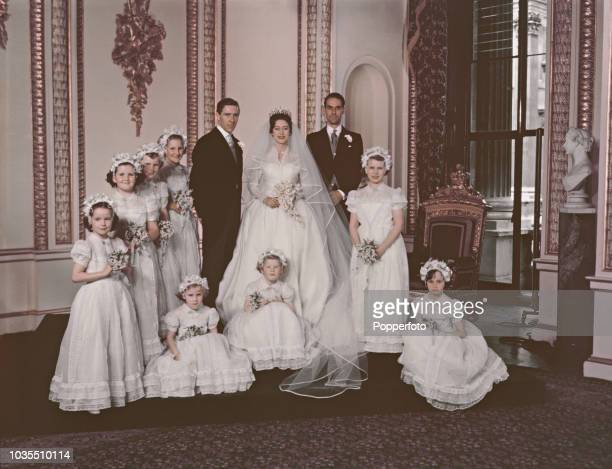 View of Princess Margaret her husband Antony ArmstrongJones best man Roger Gilliat and eight bridesmaids posed together for a formal portrait on the...
