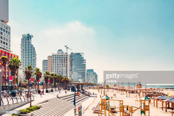view of promenade and sandy beach in tel aviv - tel aviv stock pictures, royalty-free photos & images