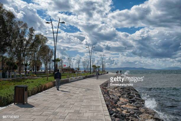 view of promenade on a cloudy day. - emreturanphoto stock pictures, royalty-free photos & images