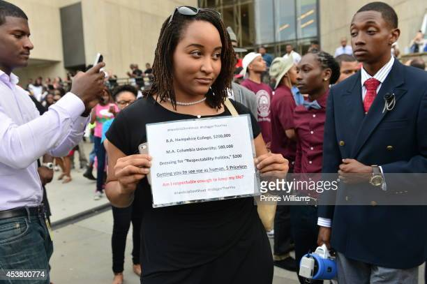 View of protesters holding signs at the Atlanta #RallyforFerguson Justice For Mike Brown at the CNN Center on August 18 2014 in Atlanta Georgia