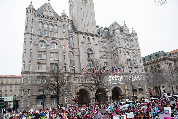 A view of protesters marching in front of the Trump International Hotel Washington DC on Pennsylvania Avenue during the Women's March on Washington...