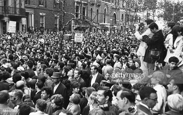 View of protestors during an antiViet Nam War demonstration on Fifth Avenue New York New York October 17 1965 A sign in the background reads 'Had Our...