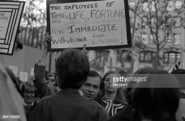 View of protestors during the Moratorium to End the War in Vietnam demonstration New York New York October 15 1969 One holds a sign that reads 'The...