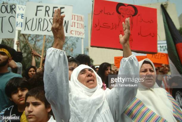 View of protestors many with signs as they march during a peace demonstration during the Gulf War Kuwait City Kuwait 1991 Among the visible signs is...