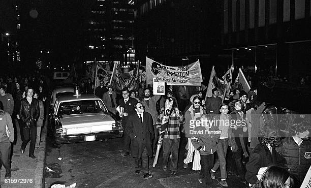 View of protestors many with signs or banners at an antiNixon demonstration outside the WaldorfAstoria hotel New York New York December 9 1969...