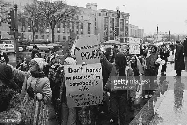 View of prowomen's rights demonstrators as they march Washington DC circa 1970s Among the visible signs is one that reads 'Don't honor me because I'm...