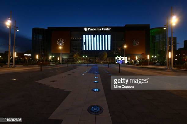 A view of Prudential Center illuminated in blue on April 16 2020 in Newark New Jersey United States Landmarks and buildings across the nation are...