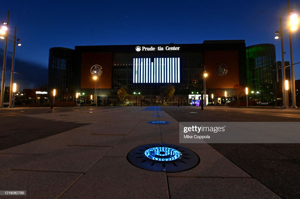 Landmarks And Stadiums Across The Country Illuminated In Blue To Honor Essential Workers : News Photo