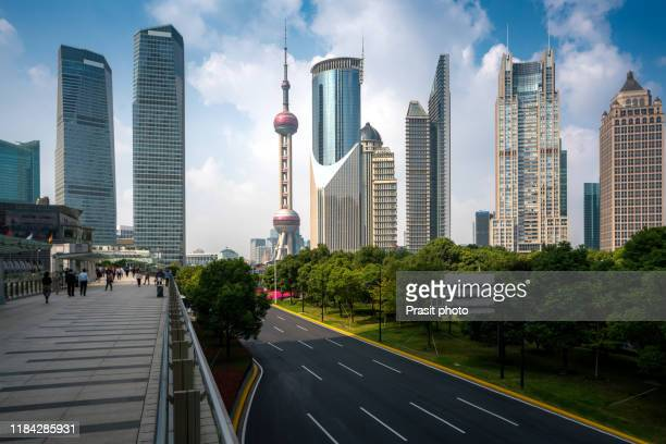 view of pudong skyline with oriental pearl tower and lujiazui business district skyscraper with skywalk in shanghai, china. asian tourism, modern city life, or business finance and economy concept - shanghai stock pictures, royalty-free photos & images