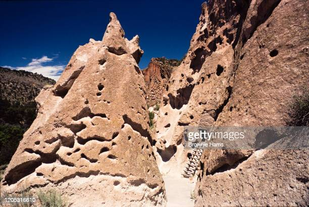 View of Pueblo cave cliff dwellings at Bandelier National Monument, Los Alamos, New Mexico, 1979.