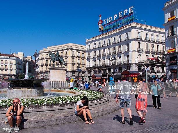 """View of """"Puerta del Sol"""" square. It is known such as the kilometer 0 in Spain and the proper center and heart of the city. The Tio Pepe ads is a..."""