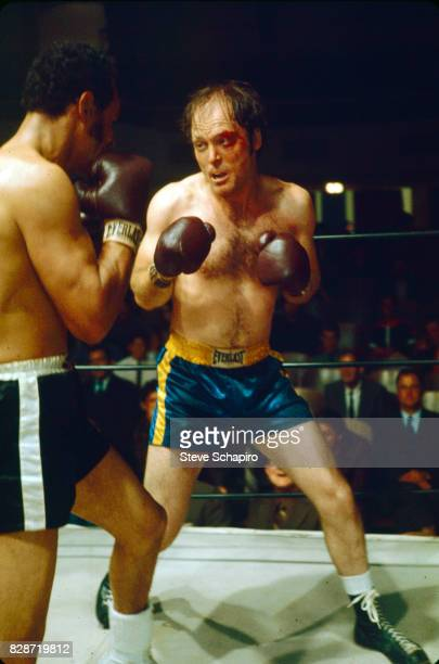 View of Puerto Rican actor Sixto Rodriguez boxes American actor Stacy Keach in a scene from the film 'Fat City' , Stockton, California, 1972.