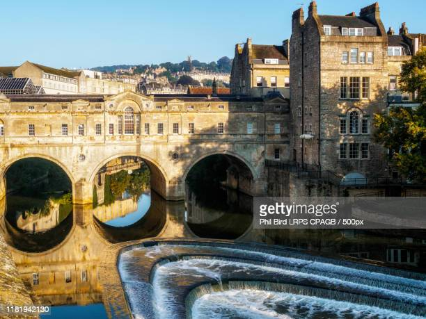 view of pulteney bridge and weir in bath - bath england stock pictures, royalty-free photos & images