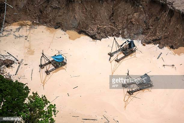 View of pumps used by illegal gold miners in Mega 13 Madre de Dios region Peru on January 25 during a police operation AFP PHOTO / Sebastian Castañeda