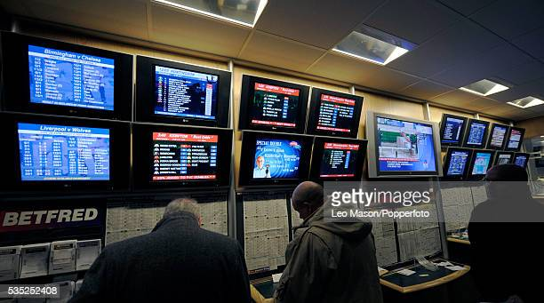 View of punters in a bookmakers as they prepare for the William Hill King George VI Chase during the 2009 Winter Festival Meeting at Kempton Park...
