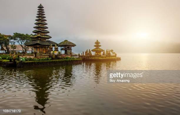 view of pura ulan danu bratan temple in bali island, indonesia at dawn. - lake bratan area stock pictures, royalty-free photos & images