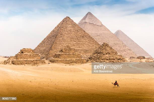 view of pyramid complex of giza, in cairo egypt - pyramid stock pictures, royalty-free photos & images
