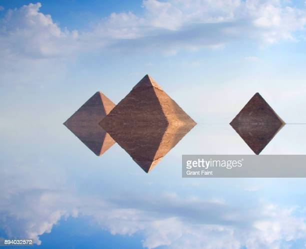 View of pyramids in desert.