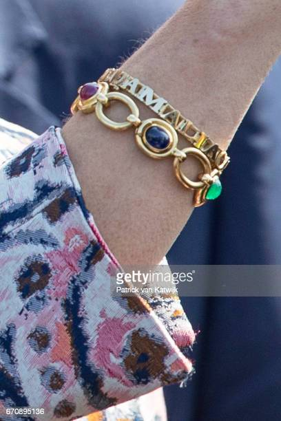 A view of Queen Maxima of The Netherlands's bracelet with the names of her three daughters during the visit to social restaurant Resto VanHarte on...