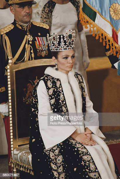 View of Queen of Iran Farah Pahlavi sitting on a throne chair during the coronation ceremony of her husband Mohammad Reza Pahlavi as Shah of Iran in...