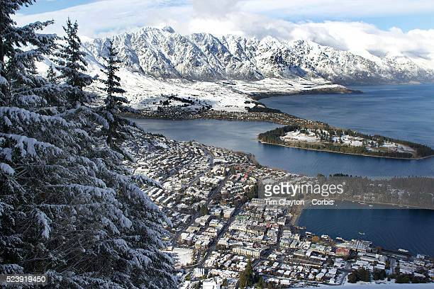 A view of Queenstown New Zealand with the snow covered Remarkables mountain range providing a stunning backdrop after winter snowfallsQueenstown is...