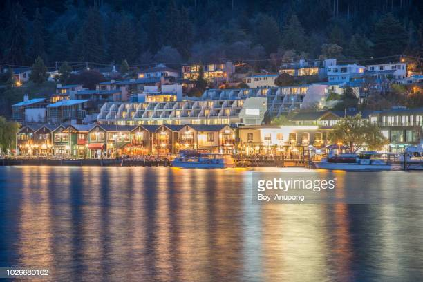 view of queenstown waterfront at night, the most popular town in south island of new zealand. - queenstown stock pictures, royalty-free photos & images