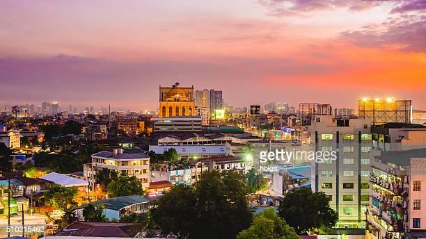 vista do horizonte da cidade de quezon durante o pôr-do-sol - cidade de quezon - fotografias e filmes do acervo