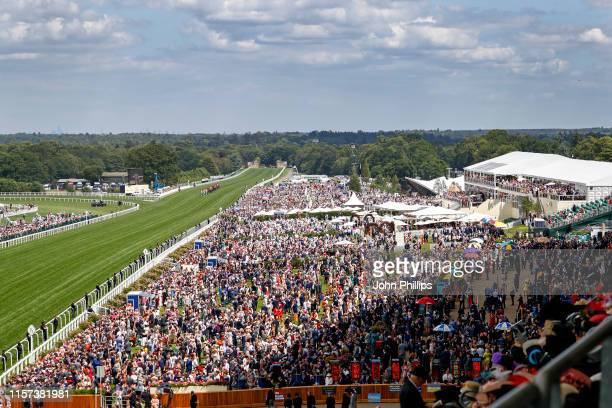 View of racegoers seen from the Royal Enclosure watching the Royal Procession on day 4 of Royal Ascot at Ascot Racecourse on June 21, 2019 in Ascot,...