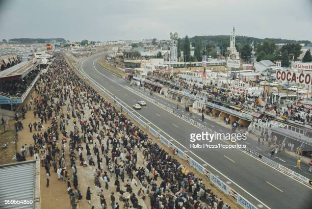 View of racing cars passing the pits on the straight during the FIA World Challenge for Endurance Drivers 1972 24 Hours of Le Mans race at the...