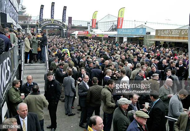 View of racing fans and punters having a drink and discussing the racing on Ladies Day during the 2012 Cheltenham National Hunt Festival at...