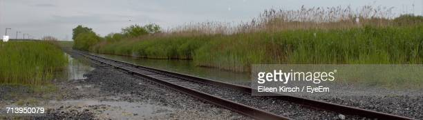 view of railroad track against cloudy sky - eileen kirsch stock pictures, royalty-free photos & images