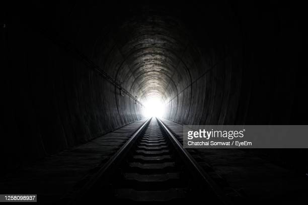 view of railroad tracks in tunnel - tunnel stock pictures, royalty-free photos & images